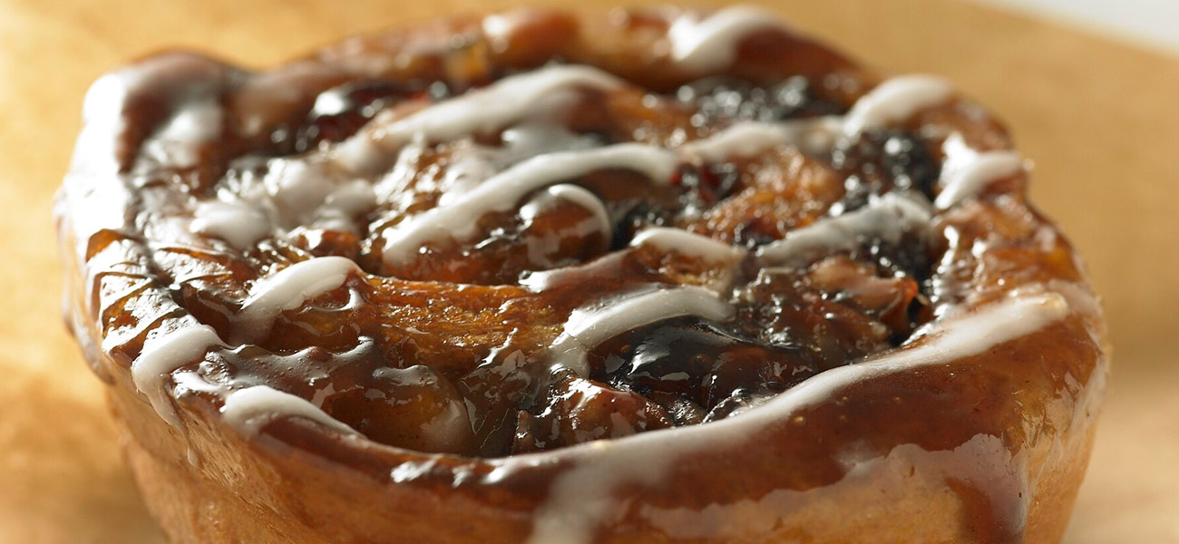 Close-up photograph of cinnamon sticky bun roll.