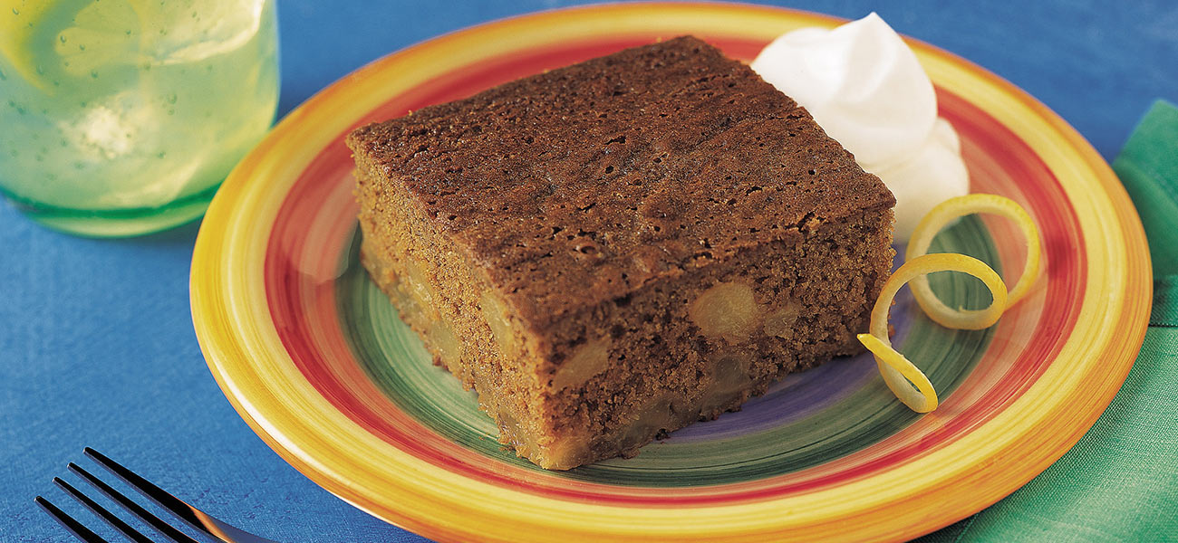 Colorful pilate with square slice of pear-gingerbread.