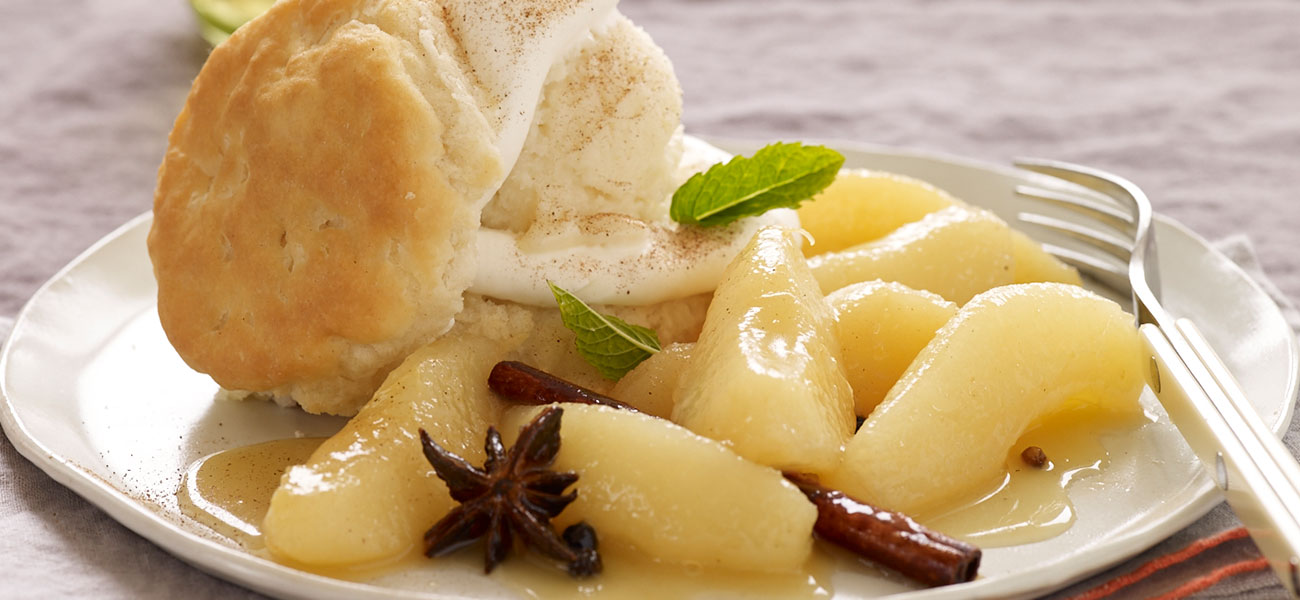 Plated shortcake with sliced pears and garnish.